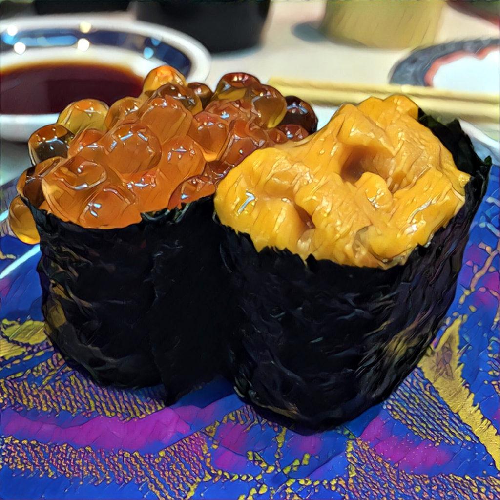 Sushi gunkanmaki with sea urchin (uni) roe and salmon roe (ikura)